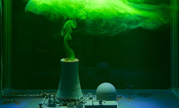 A model of a power station emitting green smoke