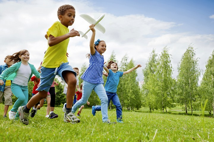 Children running with a glider