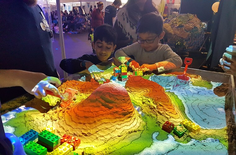 Kids experimenting with a 3D sandbox