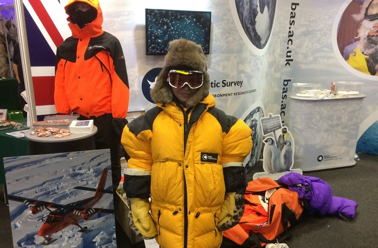 Kid dressing up in Antarctic clothing