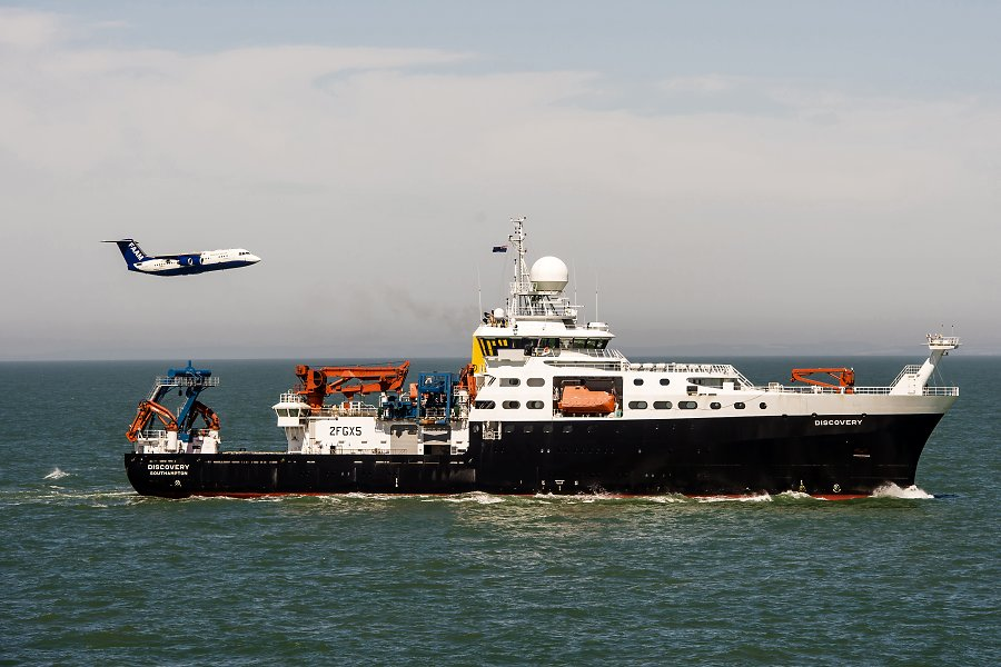 NERC research aircraft flying by RRS Discovery